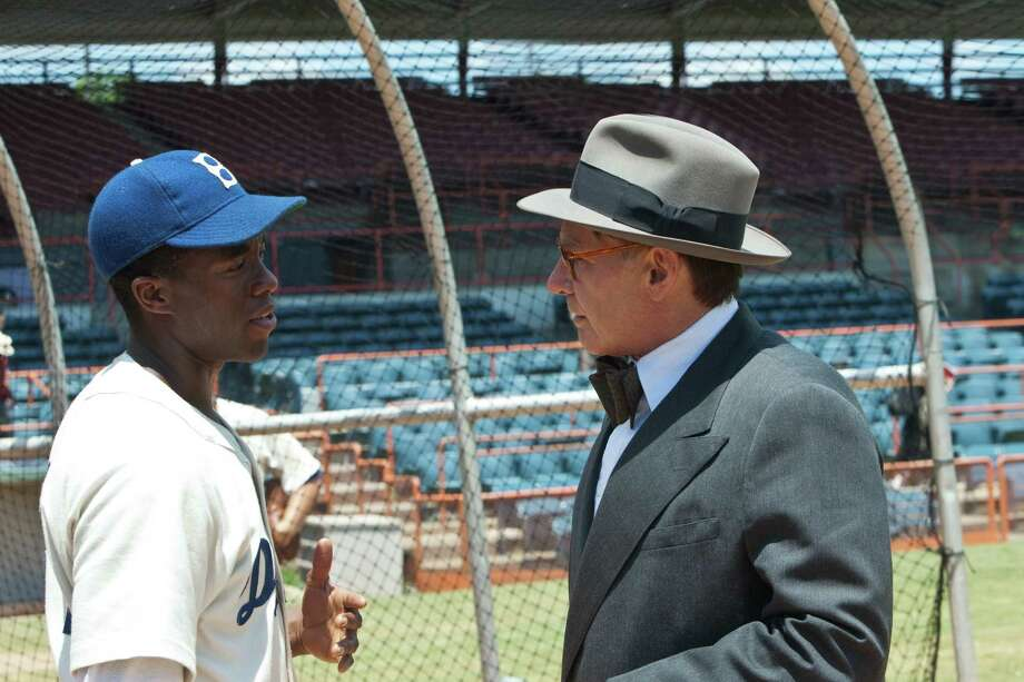 "Chadwick Boseman as Jackie Robinson and Harrison Ford as Branch Rickey in ""42.""  Photo: D. Stevens, Warner Brothers / © 2013 Legendary Pictures Productions LLC"
