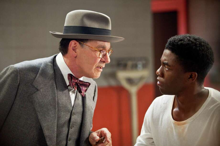 "Harrison Ford as Branch Rickey and Chadwick Boseman as Jackie Robinson in ""42."" Photo: D. Stevens, Warner Brothers / © 2013 Legendary Pictures Productions LLC"