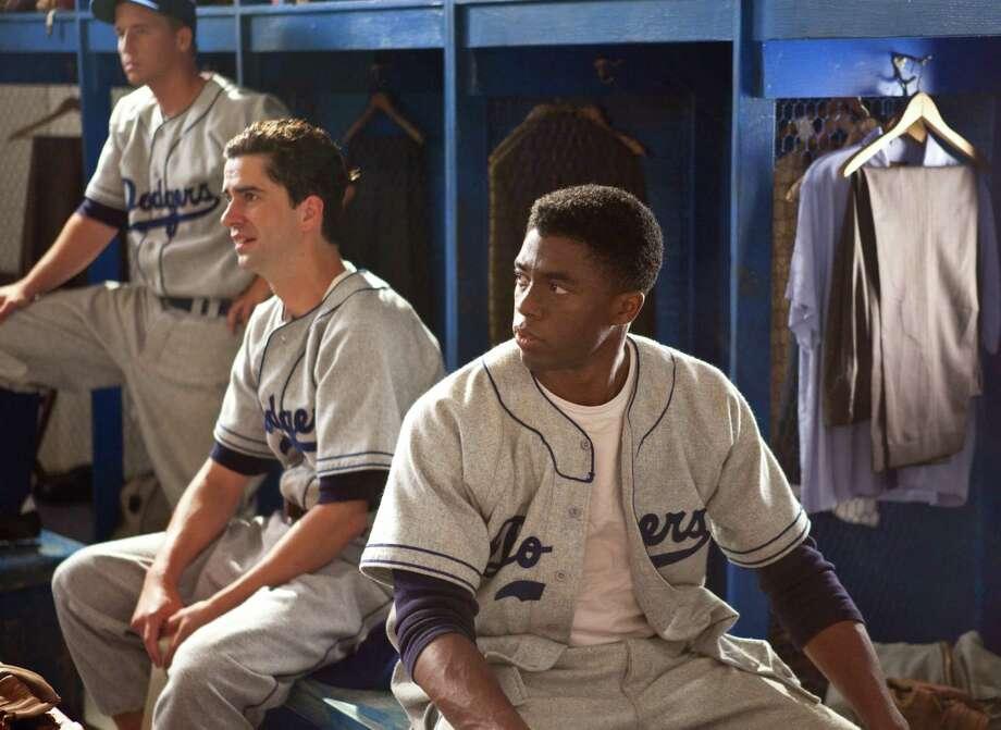 "Blake Sanders as Gene Hermanski, Hamish Linklater as Ralph Branca and Chadwick Boseman as Jackie Robinson in ""42."" Photo: D. Stevens, Warner Brothers / © 2013 Legendary Pictures Productions LLC"