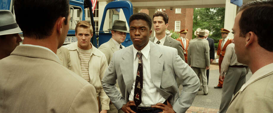 """Chadwick Boseman as Jackie Robinson, Hamish Linklater as Ralph Branca and Lucas Black as Pee Wee Reese in """"42."""" Photo: Courtesy Of Warner Bros. Picture, Warner Brothers / © 2013 Legendary Pictures Productions LLC"""