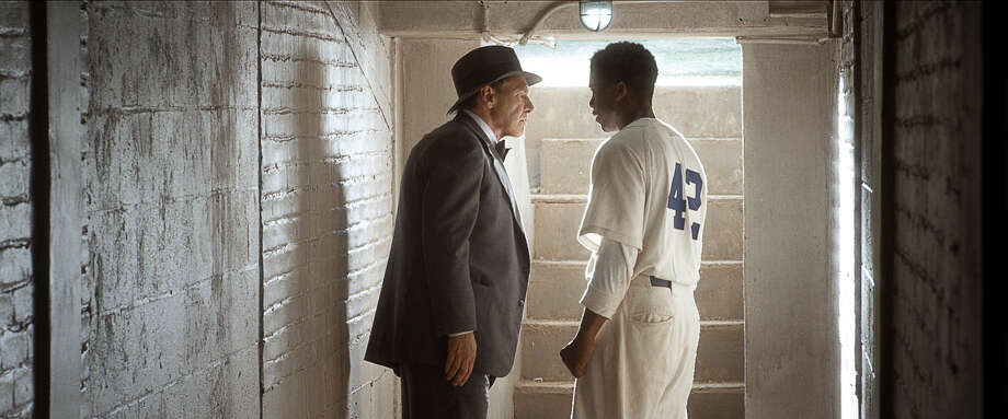 "Harrison Ford as Branch Rickey and Chadwick Boseman as Jackie Robinson in ""42."" Photo: Courtesy Of Warner Bros. Picture, Warner Brothers / © 2013 Legendary Pictures Productions LLC"