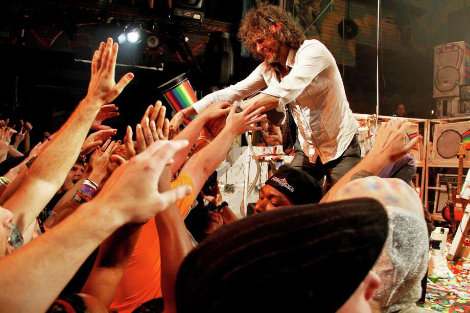 The Flaming Lips' Wayne Coyne reaches on June 28, 2012 in New Orleans, La. (Photo by Monica Mcklinski/FilmMagic) Photo: Getty Images