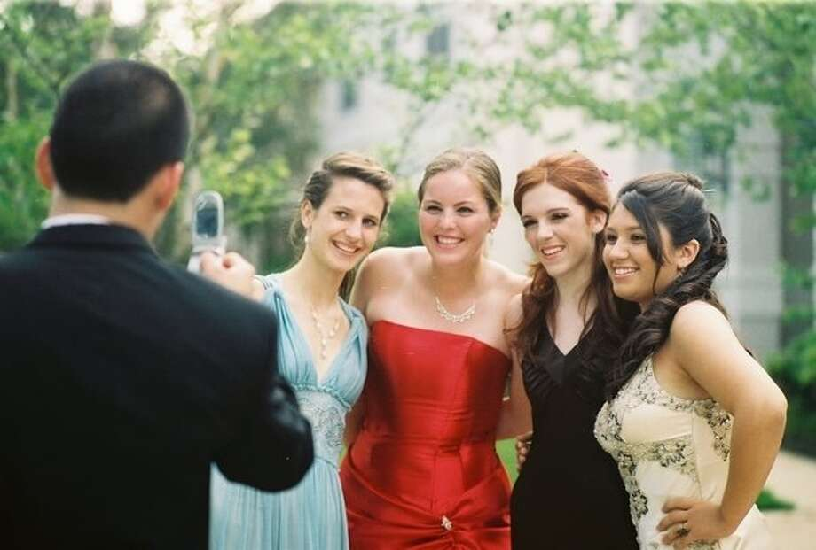 Bellaire Senior Prom 2006:  Jon Sander snaps a picture of, from left, Sarah Wesely, Madison Griffin, Kassie Altergott and Tessa Aguilar.