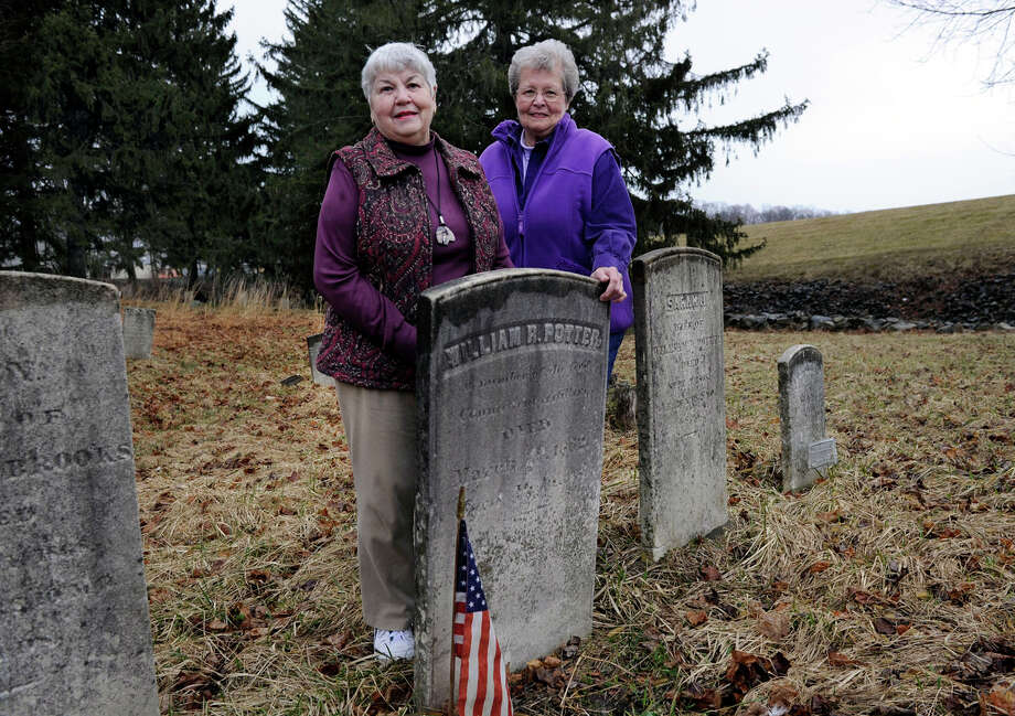 "Agnes-Betty Trimpert, 76, of Danbury, left, and Linda Decker, 74, of New Fairfield, are photographed near the graves of the Potter family in the New Fairfield Cemetery, Monday, April 1, 2013. The two have written a book about the Civil War, ""New Fairfield Answered the Call,"" which mentions the Potters. Photo: Carol Kaliff / The News-Times"
