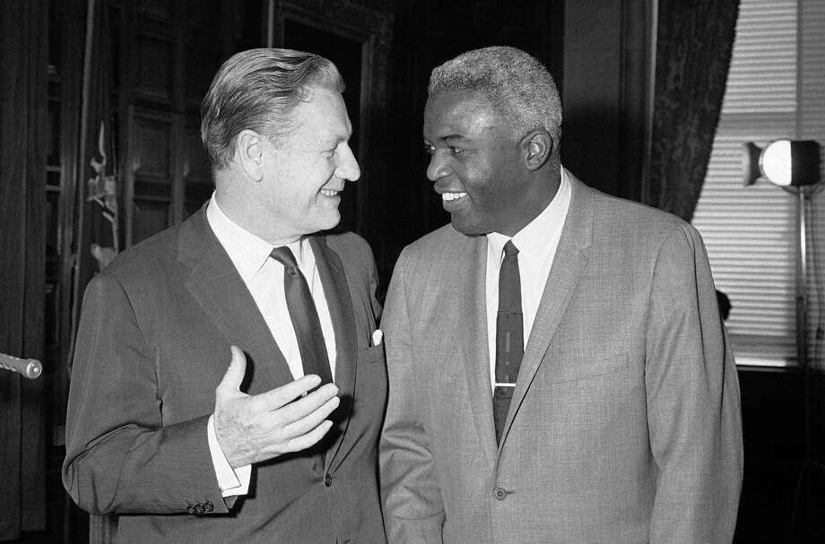 Former baseball star Jackie Robinson, right, smilingly confers with Gov. Nelson Rockefeller on his new post as a special assistant to the governor on community affairsin Albany, New York on Feb. 8, 1966. Robinson told newsmen he had turned down a job offer by New York Mayor John V. Lindsay because he, Robinson, is a �Rockefeller Republican.� (AP Photo) Photo: File