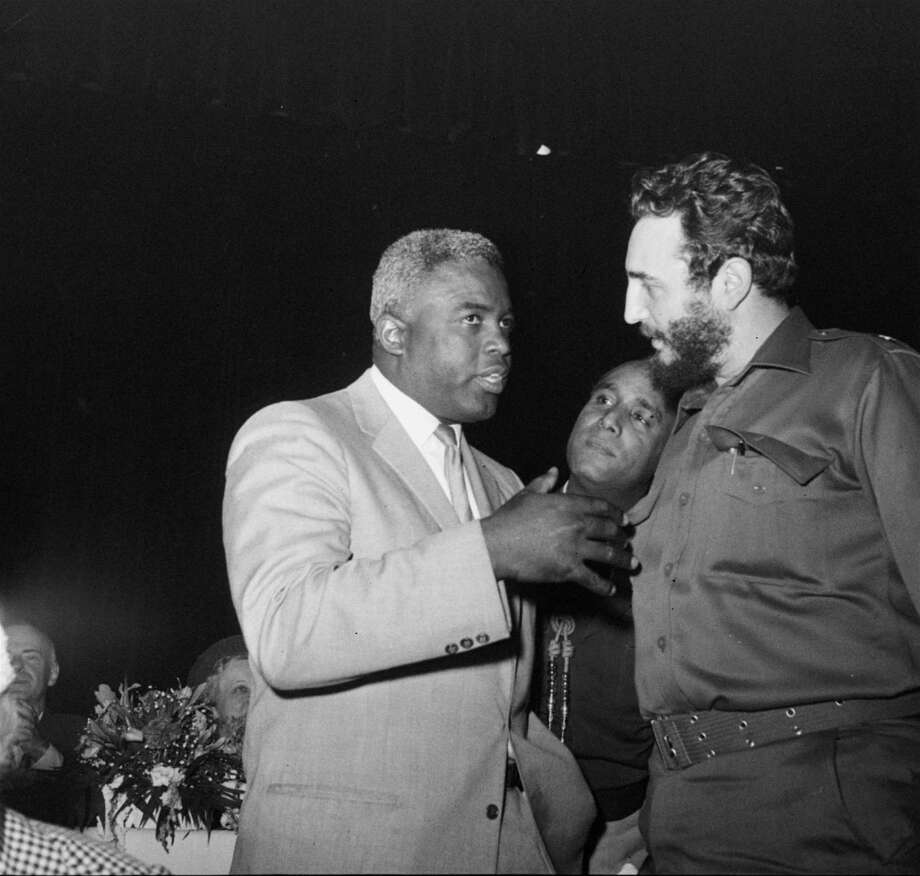 Fidel Castro, Cuban Premier, meets former baseball star Jackie Robinson at a luncheon of the Overseas Press Club at Hotel Astor in New York, April 23, 1959.  The Cuban leader, on a five day visit to New York, has said that he's a baseball fan.  Robinson, former Brooklyn Dodger star, is now a New York executive. (AP Photo) Photo: File
