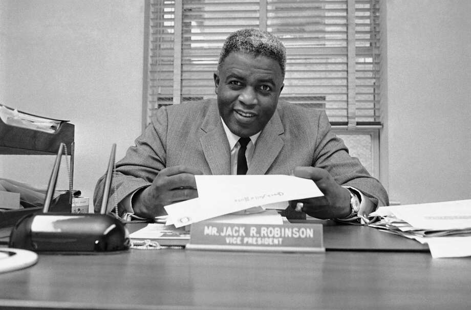 Jackie Robinson, former Brooklyn Dodger baseball player, poses in his office on Jan. 5, 1962 at Chock Full O?Nuts at 425 Lexington Avenue in New York City. (AP Photo/ John Rooney) Photo: John Rooney, File / AP1962