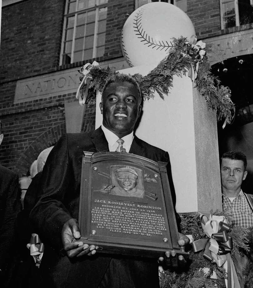 FILE -- Jackie Robinson poses with the plaque presented to him during induction ceremonies at the Baseball Hall of Fame in Cooperstown, N.Y. July 23, 1962.  A series of initiatives will be announced in New York Wednesday Feb. 26, 1997 to celebrate the 50th anniversary of Jackie Robinson's entry into the major leagues and the barrier-breaking spirit that guided Robinson throughout he life as an athlete, businessman and social activist. Photo: File / AP1962