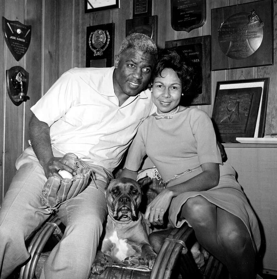 Former baseball great Jackie Robinson is seen with his wife Rachel at home in Stamford, Conn., on January 23, 1962, shortly after he was voted into baseball's Hall of Fame. Robinson, the first black athlete to play with a major league team, the Brooklyn Dodgers, is also the first black to become a Hall of Famer. (AP Photo) Photo: File / AP1962