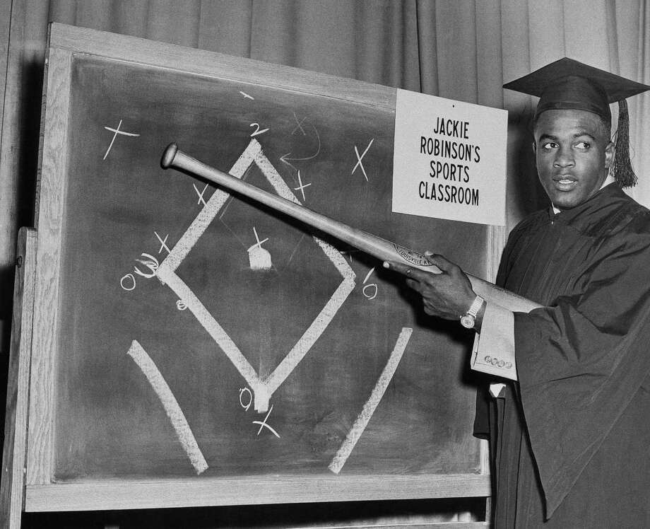 "Baseball player Jackie Robinson rehearses for his forthcoming tv program, ""Jackie Robinson's Sports Classroom,"" at WPIX-TV tv station in New York, Dec. 13, 1950. (AP Photo) Photo: File / 1950 AP"