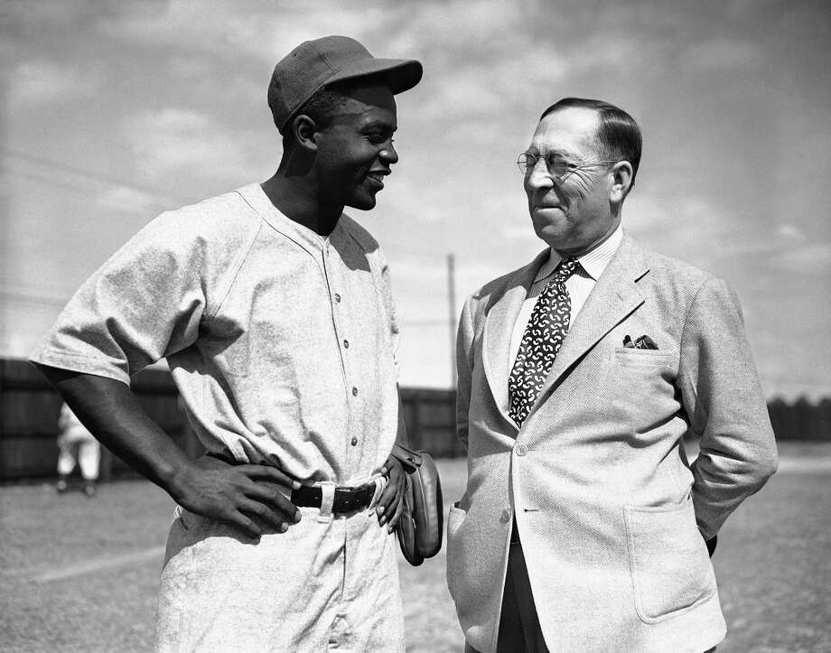 Brooklyn Dodgers' Jackie Robinson chats with Robert L. Finch, assistant to club President Branch Rickey, shortly before he reported as a player with the Montreal Royals at Sanford, Florida, March 4, 1946. (AP Photo/Bill Chaplis) Photo: Bill Chaplis, File / 1946 AP