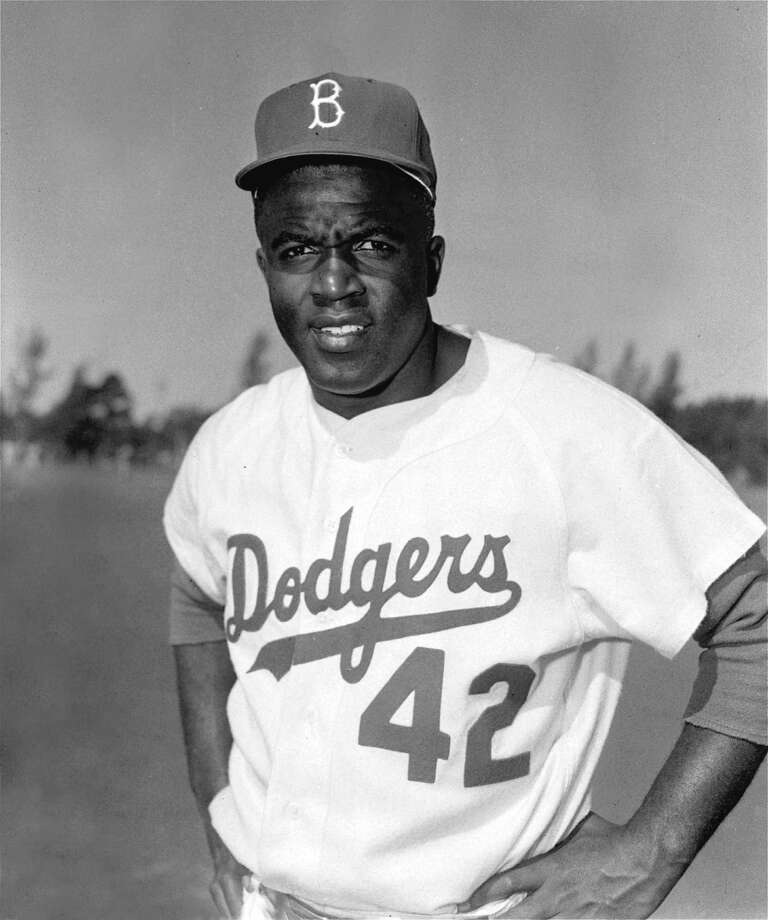 Jackie Robinson, Brooklyn Dodgers infielder, is photographed during spring training at Vero Beach, Florida, March 1956.  It would be Robinson's tenth and last year with the Dodgers. (AP Photo) Photo: File / AP1956
