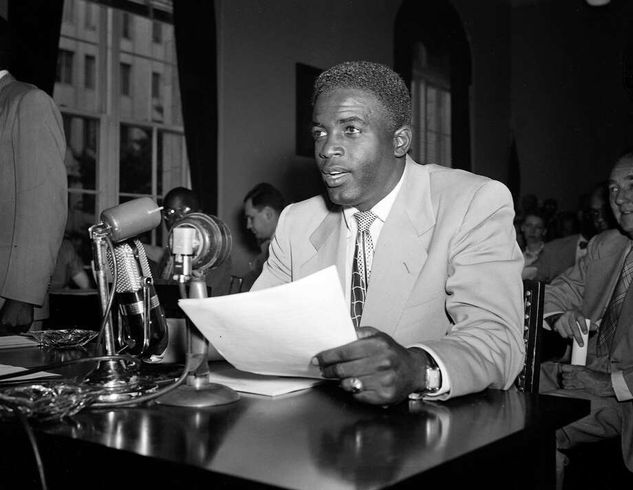 "Brooklyn Dodgers' star Jackie Robinson speaks before the House Un-American Activities committee, July 18, 1949.  Robinson said African Americans would fight for this country ""against Russia or any other enemy.""  (AP Photo/William J. Smith) Photo: File"