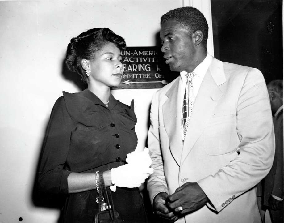 Jackie Robinson, star infielder of the Brooklyn Dodgers, and his wife, Rachel, stand outside the House Un-American Activities Committee Hearing Room in Washington, D.C. on July 18, 1949. Robinson is called to testify about the loyalty of blacks to the United States. (AP Photo) Photo: File / AP1949