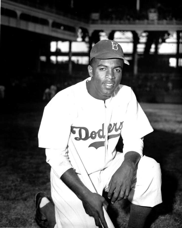 Jackie Robinson of the Brooklyn Dodgers poses at Ebbets Field in Brooklyn, N.Y., April 11, 1947.  (AP Photo/John Rooney) Photo: File