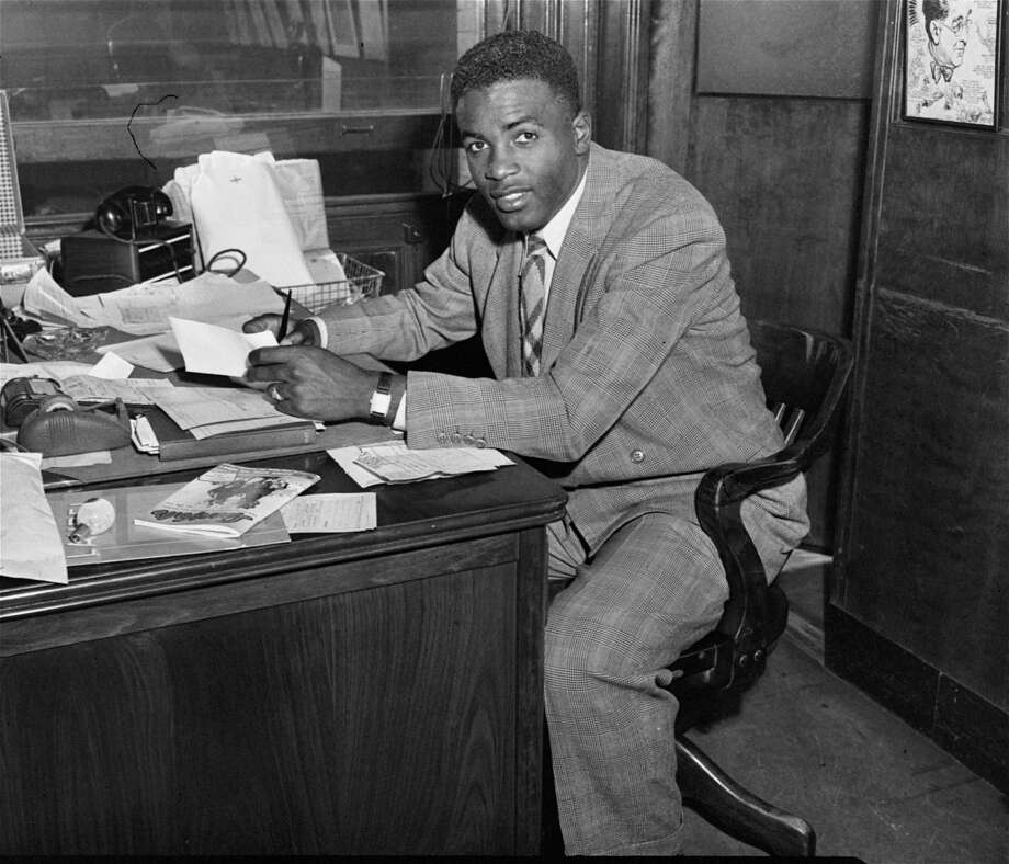 Jackie Robinson, first African American to ever be admitted into the major leagues, photographed right after he signed his contract with the Brooklyn Dodgers at the Dodgers office, April 10, 1947.  (AP Photo) Photo: File