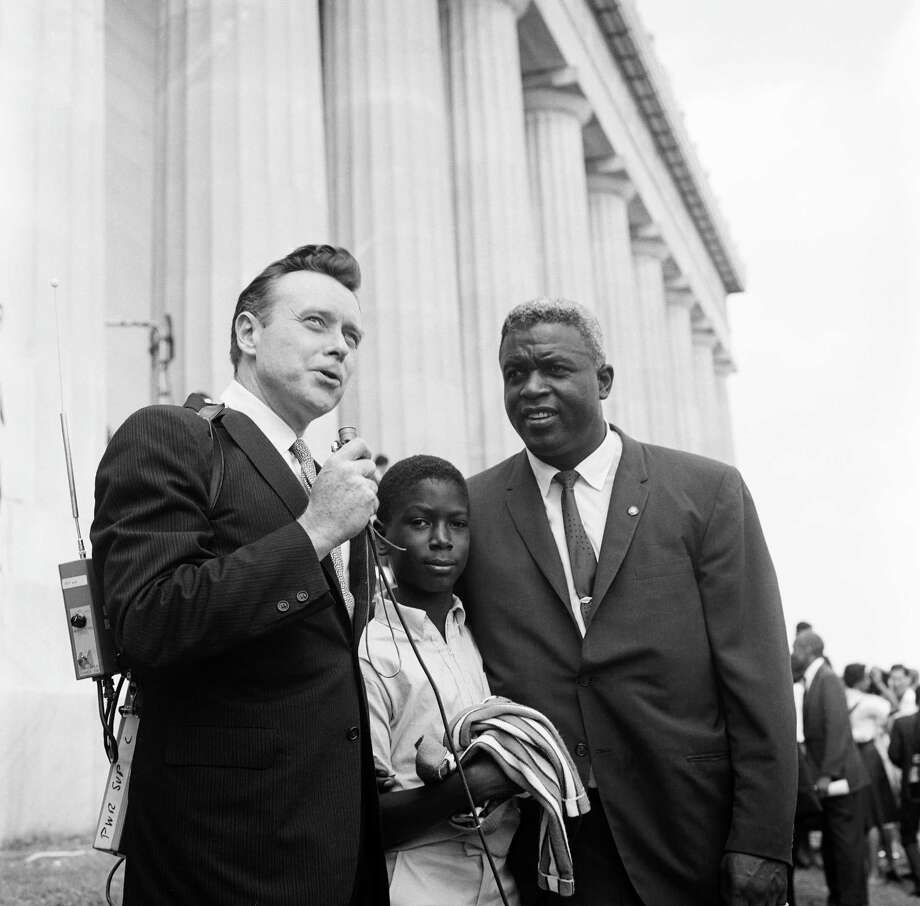 "NBC News' Merrill ""Red"" Mueller, son David Robinson, baseball player Jackie Robinson during an interview at Lincoln Memorial during the March on Washington for Jobs and Freedom political rally in Washington, DC on August 28, 1963. Photo: NBC, File / 2012 NBCUniversal Media, LLC"