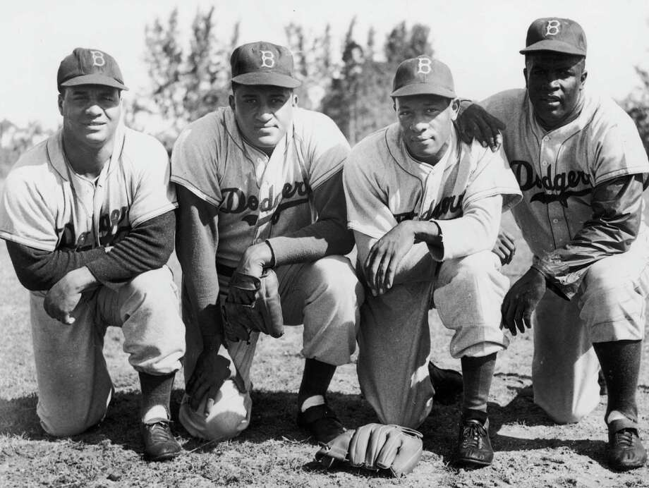 First meeting for these four Brooklyn Dodgers, left to right, Roy Campanella, Don Newcombe, Dan Bankhead and Jackie Robinson at Vero Beach, Florida. Photo: Curt Gunther, File / 2010 Getty Images