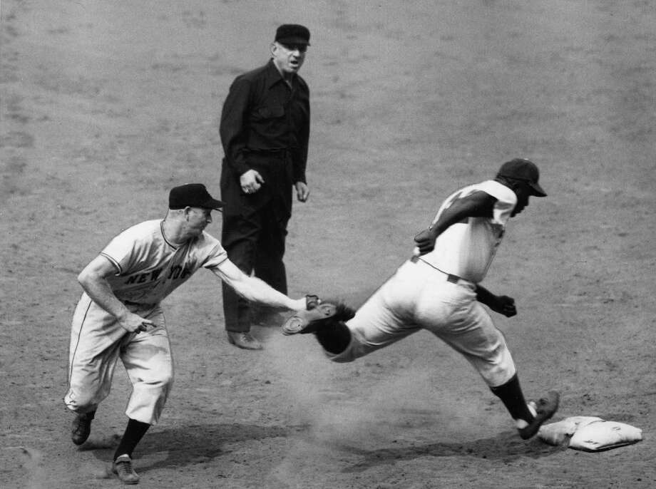 Jackie Robinson is tagged out by New York Giants first baseman Whitey Lockman in a game at Ebbets Field in Brooklyn in 1948. Photo: Transcendental Graphics, File / 2006 Mark Rucker/Transcendental Graphics