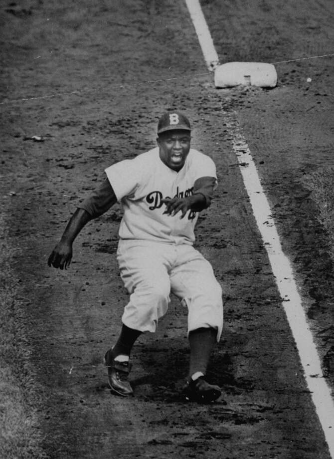 Dodger player Jackie Robinson coming down third base line in game against the Yankees in the 1955 World Series. Photo: Ralph Morse, File / Time & Life Pictures
