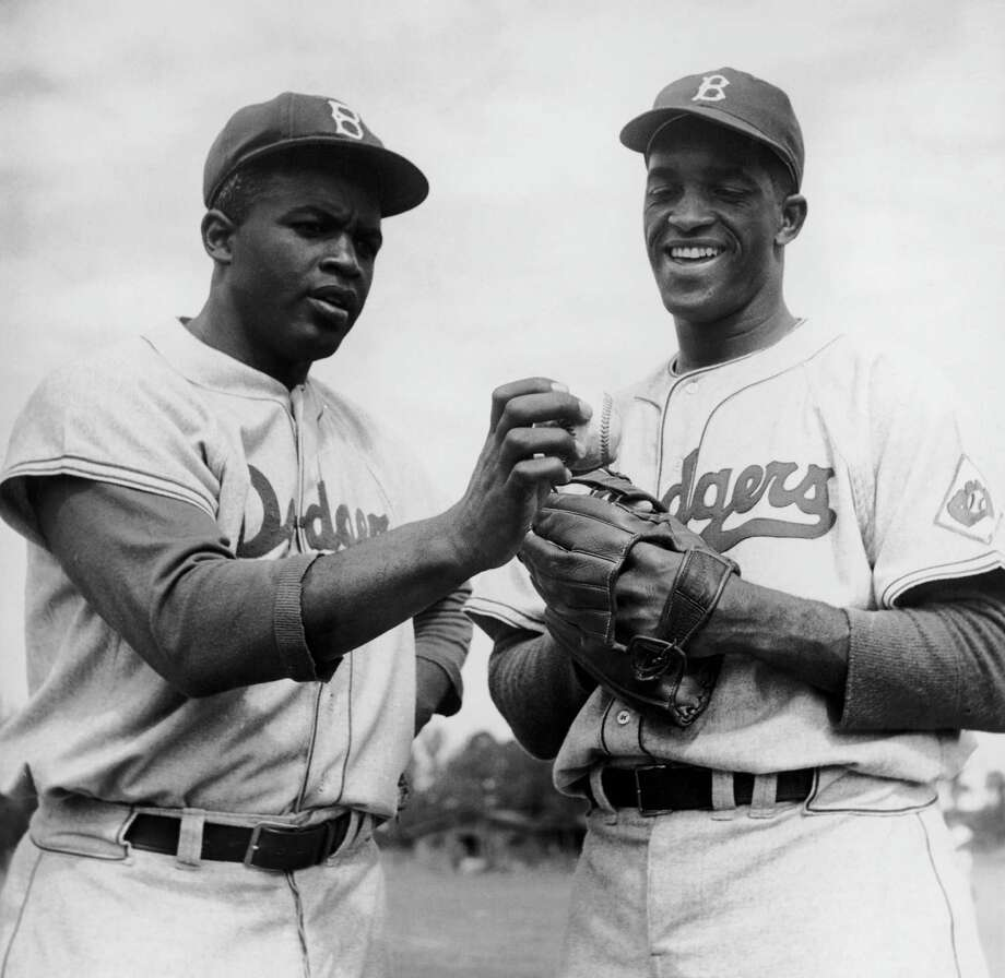 American baseball players Jackie Robinson, left, and Joe Black of the Brooklyn Dodgers, circa 1952. Photo: Curt Gunther, File / 2006 Getty Images