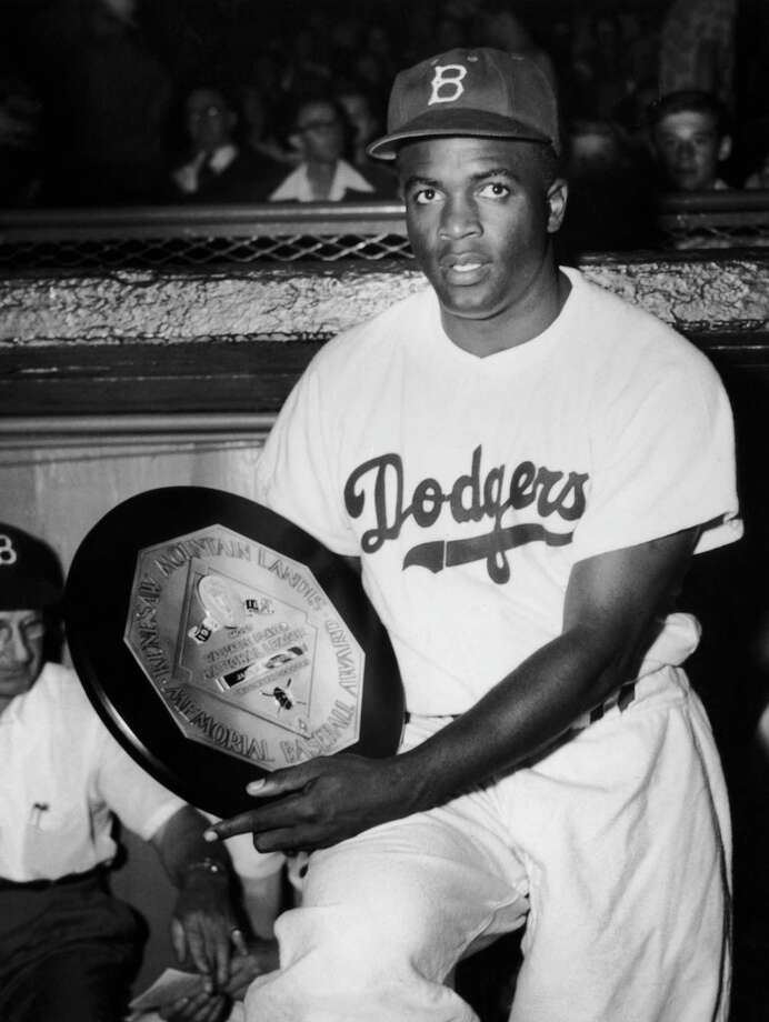 Jackie Robinson with his National League's Most Valuable Player award from the baseball writers association, July 1950. He is only the fourth Brooklyn Dodgers player to win the award. Photo: FPG, File / 2006 Getty Images