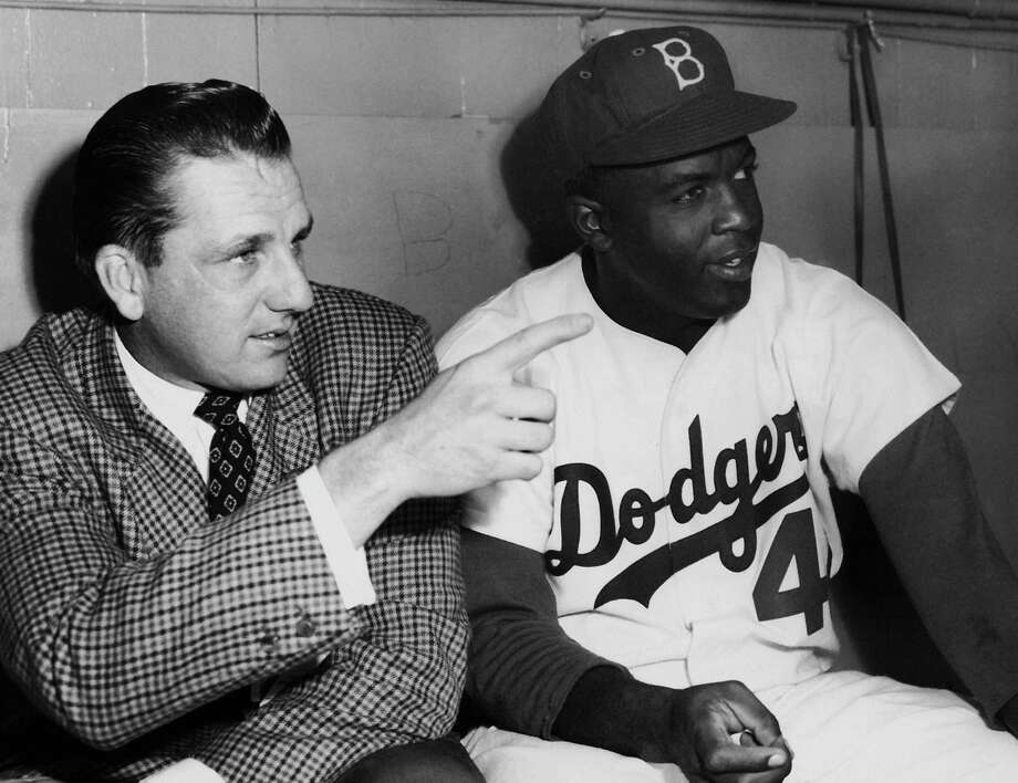 Ex-baseball player Ralph Kiner talking to Brooklyn Dodger batsman Jackie Robinson before the opening game of the World Series, in October 1952. Photo: Curt Gunther, File / 2006 Getty Images