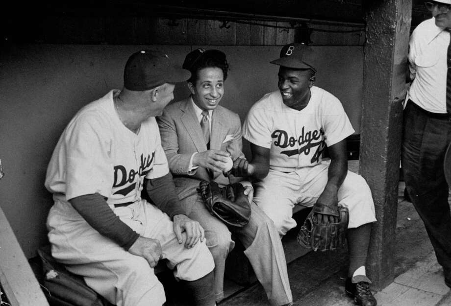 Dodgers manager Charles Dressen, left, talking with Iraq's King Feisal II, center, and Jackie Robinson, right, in 1952. Photo: Yale Joel, File / Time Life Pictures