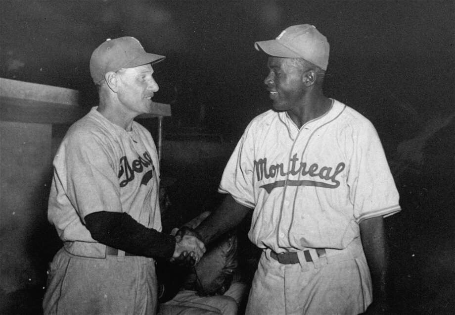 Brooklyn Dodger manager Leo Durocher shakes hands with Jackie Robinson, Montreal Royals' first baseman, as the Dodgers and Royals play an exhibition game in Havana, Cuba, March 31, 1947.  Robinson, the first black to play organized baseball, is a prospect of the Brooklyn entry in the National League. (AP Photo) Photo: File