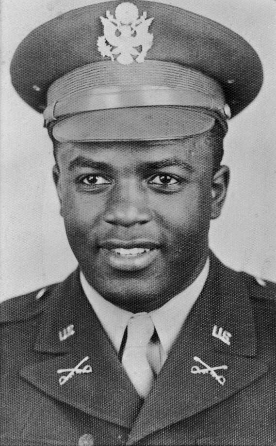 American baseball player Jackie Robinson during his wartime service as a second lieutenant in the United States Army, circa 1943. Photo: Murray Garrett, File / 2008 Getty Images