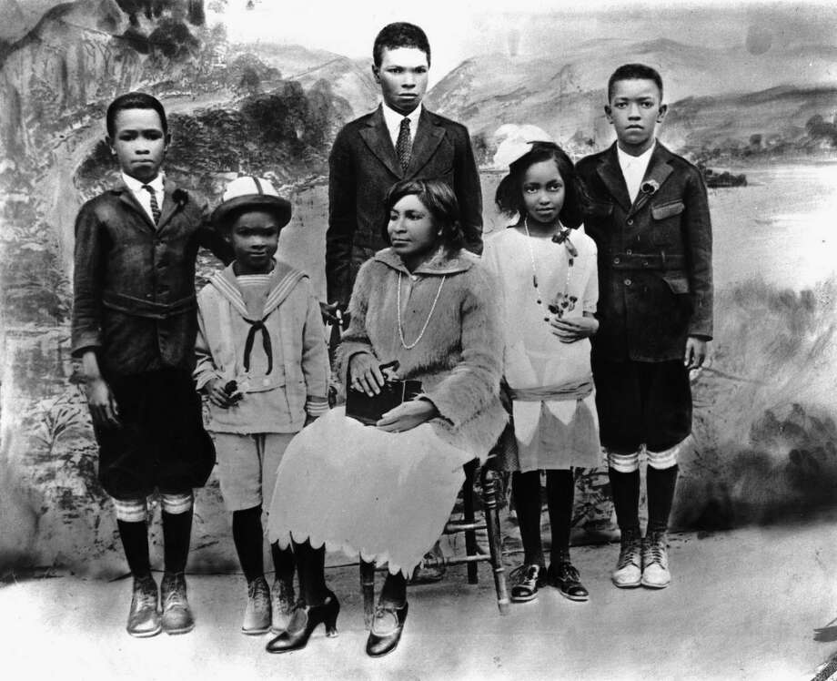 Mallie Robinson, center, poses for a family portrait with her children, left to right, Mack Robinson, Jackie Robinson, Edgar Robinson, Willa Mae Robinson and Frank Robinson circa 1925 in California. Raised in Pasadena, Jackie Robinson went on to be the first African-American to play American Major League Baseball. Photo: Hulton Archive, File / 2003 Getty Images