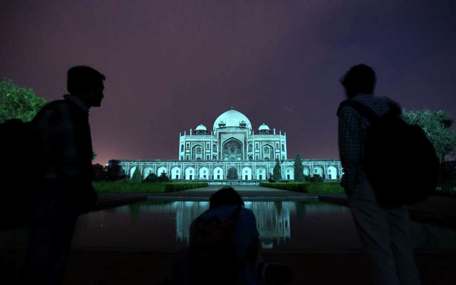 Humayun's Tomb is lit up in blue to mark World Autism Day in New Delhi, India, Tuesday, April 2, 2013. Photo: Altaf Qadri, Associated Press / AP