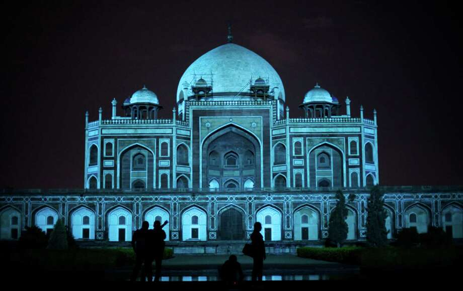 Humayun's Tomb is lit up in blue to mark World Autism Day in New Delhi, India, Tuesday, April 2, 2013.Learn more about World Autism Awareness Day. Photo: Altaf Qadri, Associated Press / AP