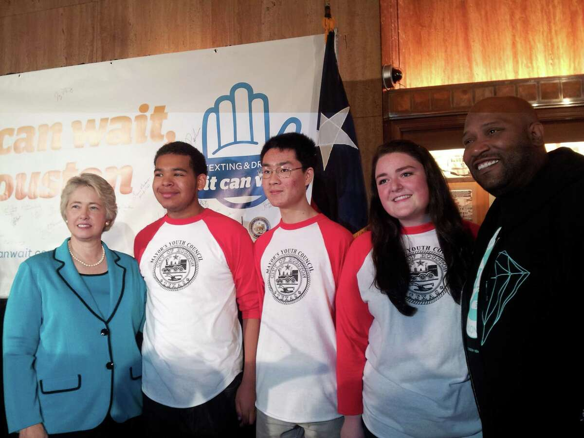 Mayor Parker and rapper Bun B, right, flank and Mayor's Youth Council members Christian Dunn, William Wu and Elizabeth Lippman at Tuesday's kickoff.