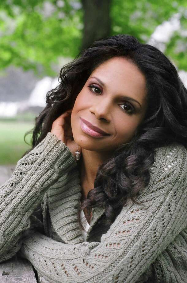 Audra McDonald, a five-time Tony Award winner, will perform in concert at the Palace Theatre in Stamford, Conn., Saturday, April 6, 2013. Backed only by a pianist, she will share stories about and perform some of her favorite tunes from stage and screen. For more information, visit http://www.scalive.org. Contributed photo/Michael Wilson Photo: Contributed Photo