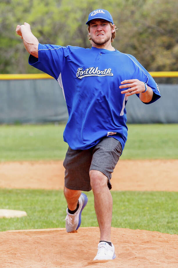 Former Clark standout Cameron Dullnig throws out the first pitch during opening day ceremonies for Northside Suburban Little League in O.P. Schnabel Park on March 23.  The league is celebrating its 60th year this season. Dullnig, who recently signed to play with the independent-league Ft. Worth Cats, began his baseball career at Northside Suburban. Photo: MARVIN PFEIFFER, Marvin Pfeiffer / Northwest Weekly / Prime Time Newspapers 2013