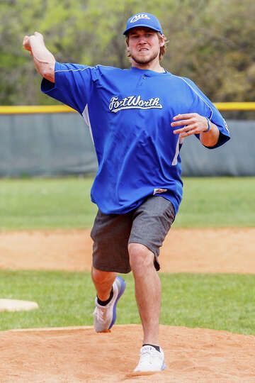 Former Clark standout Cameron Dullnig throws out the first pitch during opening day ceremonies for N