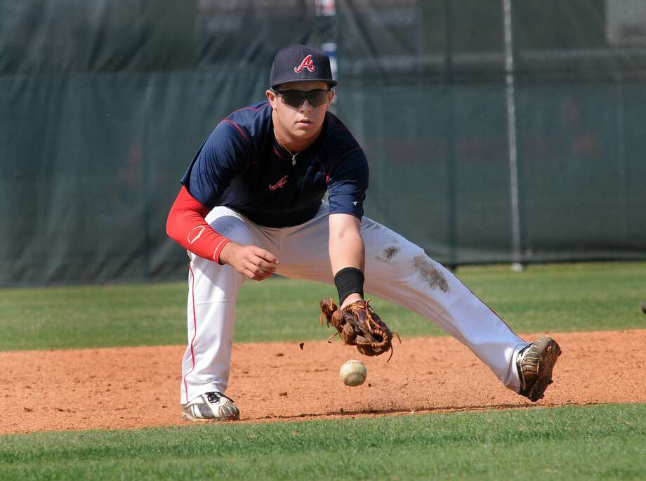 Atascocita senior third baseman Colby Brouillette fields a grounder during a Monday practice session. Photo: Jerry Baker, Freelance