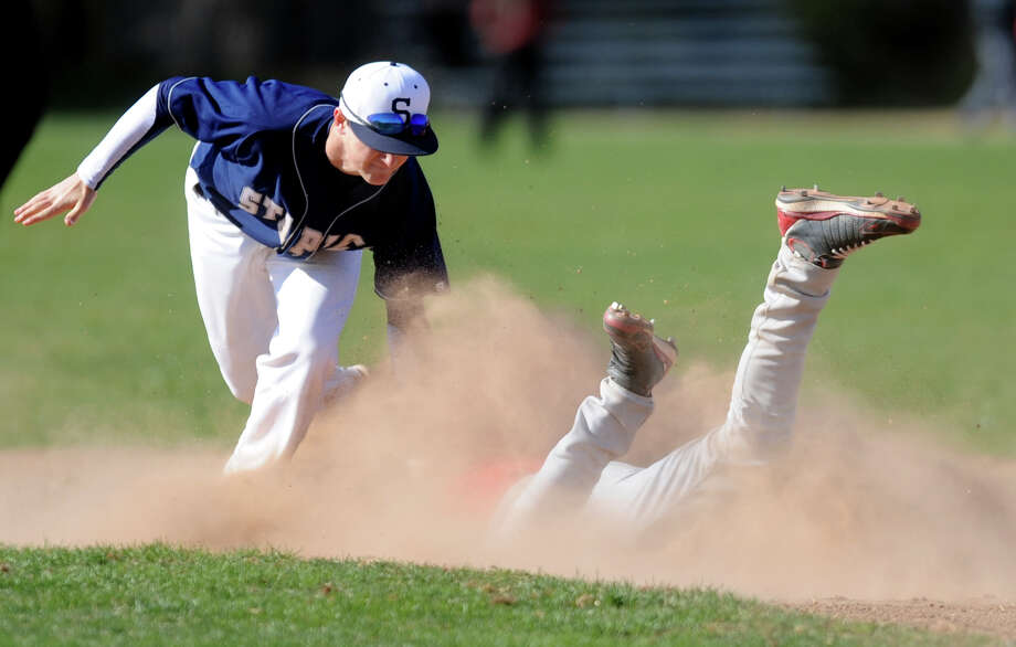Staples' Sam Ellinwood tags a Fairfield Warde runner out at second base during a preseason scrimmage Tuesday, Mar. 27, 2012 at Fairfield Warde. Photo: Autumn Driscoll / Connecticut Post