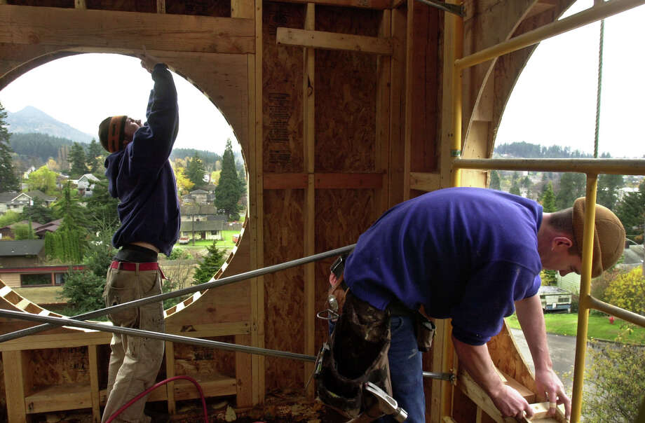 169. Bellingham: 28.8 percent highly religious, 50.4 percent not religious. Here, workers remodel a former church steeple into a home/studio in Bellingham. Photo: Ron Wurzer/seattlepi.com File