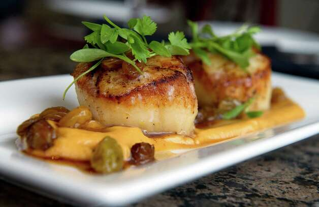 Seared sea scallops with smoked cauliflower fondue and sweet and sour ...