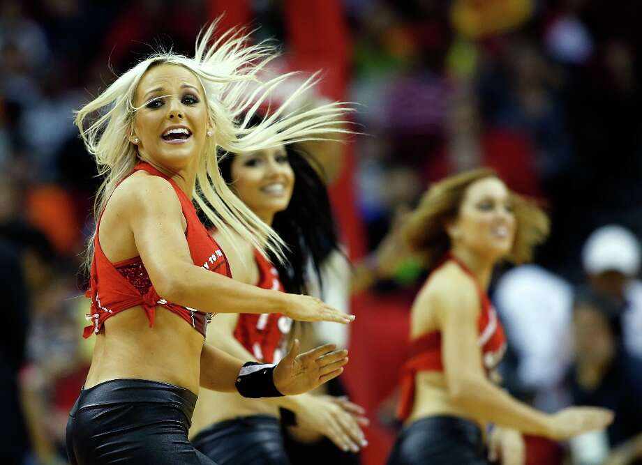 3000 x 2173~~$~~HOUSTON, TX - MARCH 15:  The Houston Rockets dancers perform on the court during the game against the Minnesota Timberwolves at Toyota Center on March 15, 2013 in Houston, Texas. NOTE TO USER: User expressly acknowledges and agrees that, by downloading and or using this photograph, User is consenting to the terms and conditions of the Getty Images License Agreement. Photo: Scott Halleran / 2013 Getty Images