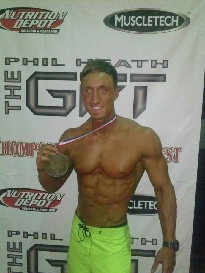 Alec Davison, a former linebacker at Clements, holds the bronze medal he won in the Physique category at The Phil Heath Classic. Photo: COURTESY ALEC DAVISON