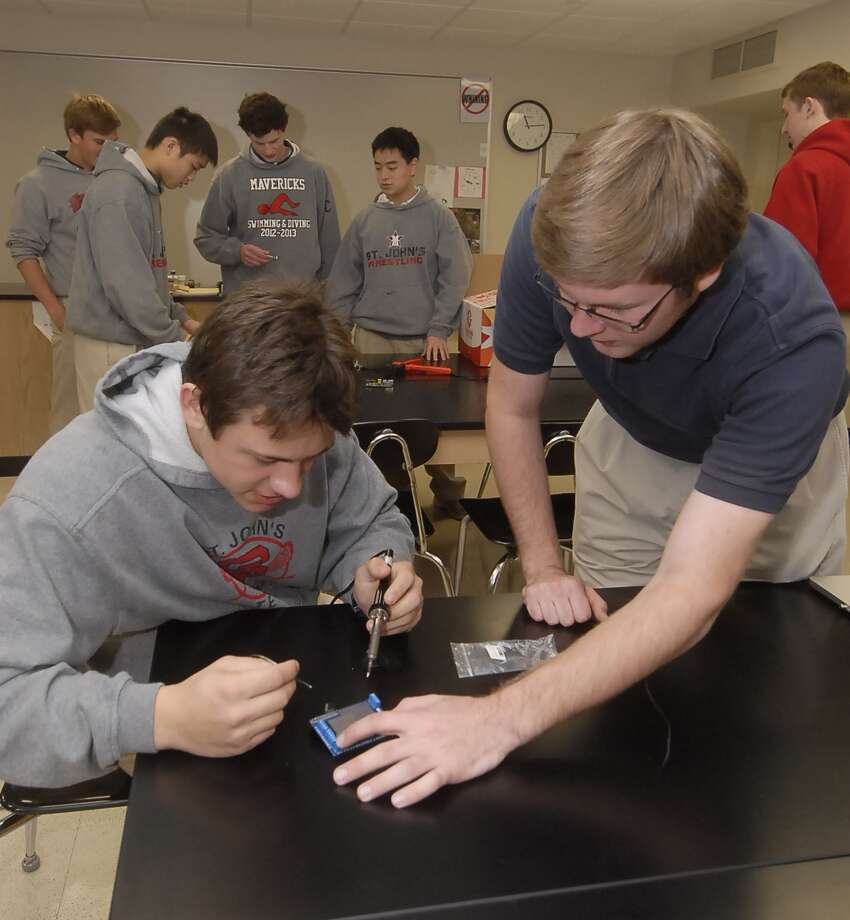 Jake Nyquist and Michael Timte, both 17, solder a circuit board for St. John's School's entry in the Shell Eco-marathon competition for fuel-efficient vehicles. Photo:  Tony Bullard 2013, Freelance Photographer / © Tony Bullard & the Houston Chronicle