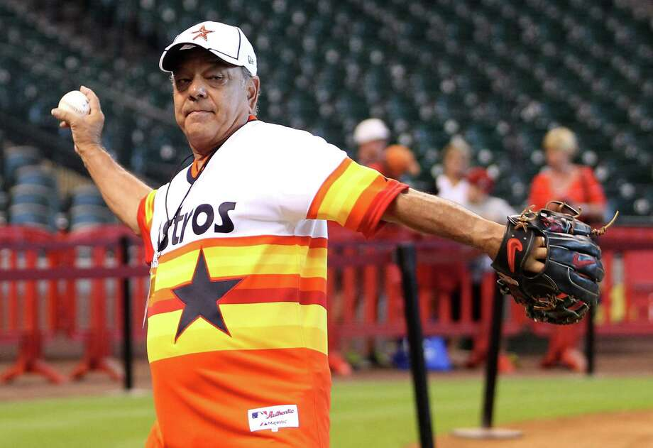 Cheech Marin, of Cheech and Chong fame, warms up as he prepares to throw out the first pitch tonight, before the start of an MLB baseball game at Minute Maid Park, Wednesday, Sept. 12, 2012, in Houston. Photo: Karen Warren, Houston Chronicle / © 2012  Houston Chronicle