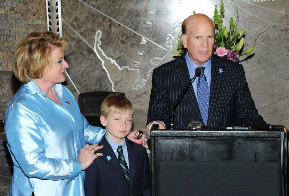 """""""Autism Speaks"""" co-founder Suzanne Wright, left, grandson Mattais Hildebrand, and """"Autism Speaks"""" co-founder Bob Wright attend Empire State Building autism awareness month lighting on Tuesday April 2, 2013 in New York. Photo: Evan Agostini, Associated Press / Invision"""