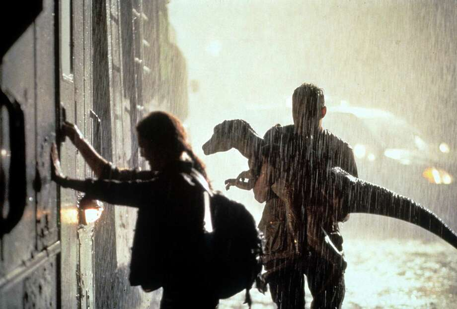 Julianne Moore grabs the door of a train as Vince Vaughn holds a small dinosaur in a scene from the film 'The Lost World: Jurassic Park.' Photo: Archive Photos, Getty Images / 2012 Getty Images