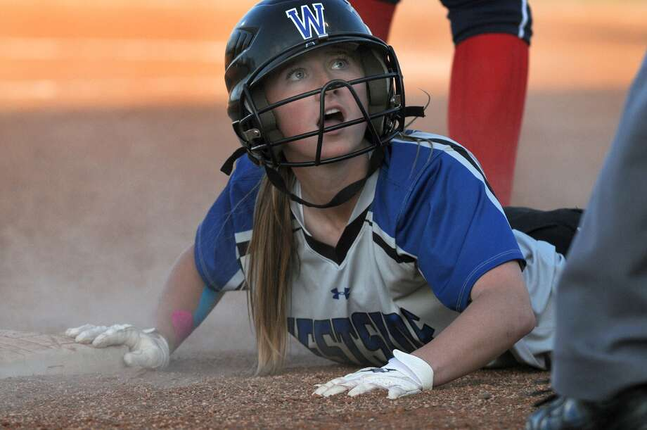 Westside freshman Mary Alex Krosby and the Wolves have been aggressive on the base paths this season, which they credit with their strong start in league play. Photo: Jerry Baker, Freelance