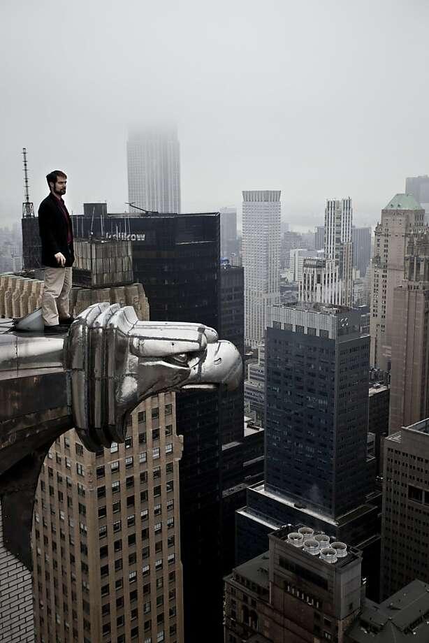 Moses Gates atop the Chrysler Building in New York. Photo: Simon Yorkston