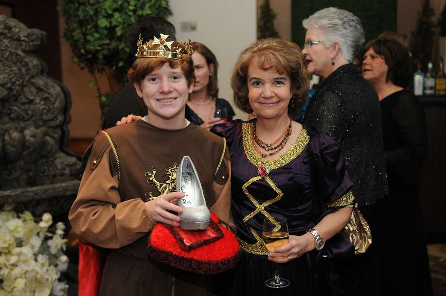 "Carl Marth, 16, from left, a sophomore at Dulles High School, with his mom, Mary Bourne-Marth, a Fort Bend Education Foundation board member, posed as ""Prince Charming"" during the foundation's fundraising gala held at the Sugar Land Marriott. Freelance photo by Jerry Baker Photo: Jerry Baker, Freelance"